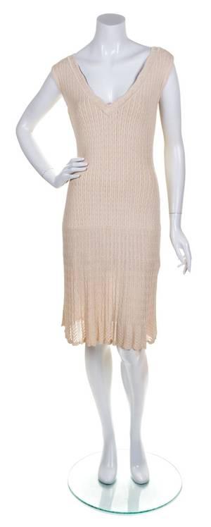 An Alaia Cream Ribbed Knit Dress