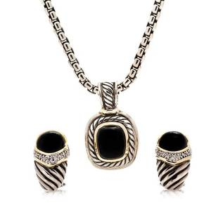 A Collection of Sterling Silver Yellow Gold Onyx and Diamond Jewelry David Yurman
