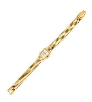 A 14 Karat Yellow Gold Wristwatch Tourneau