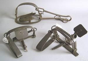 Three wrought iron animal traps 18th19th c