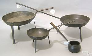 Three Pennsylvania wrought iron cooking spiders 19th c