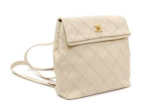 A Chanel Cream Caviar Leather Quilted Backpack