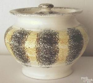 Yellow and black rainbow spatter covered sugar bowl