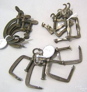 Three sets of four Pennsylvania wrought iron quilting frame clamps