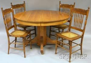 Late 19thEarly 20th Century Circular Oak Pedestalbase Dining Table and a Set of Four Pressed Oak Chairs with Caned Seats
