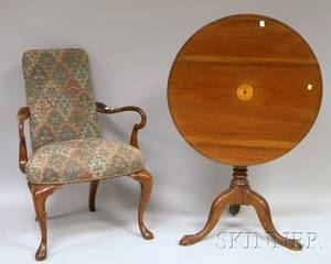 Chippendalestyle Inlaid Mahogany Tilttop Tea Table and a Queen Anne Style Upholstered Carved Walnut Armchair