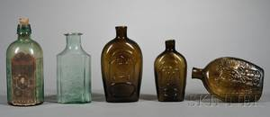Three Glass Whiskey Flasks and Two Medicine Bottles