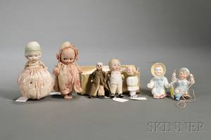 Four Small AllBisque Dolls and Three Small Bisque Figures
