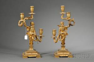 Pair of Louis XV Style Giltbronze Fourlight Candelabra