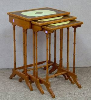 Georgianstyle Nest of Three Inlaid Maple and Mahogany Stands with Tooled Leatherinset Tops