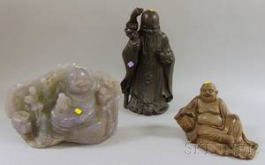 Two Asian Hardstone Reclining Buddha Figures and a Ceramic Figure of an Immortal