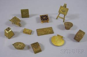 Twelve Assorted Metal Figural Sewing and Postal Stamp Articles