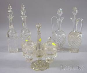 Two Pairs of Colorless Cut Glass Decanters and a Pair of Anglo Colorless Cut Glass Sweetmeat Jars in Stand
