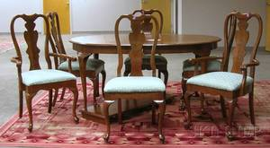 Queen Anne Style Walnut Dining Table with a Set of Six Dining Chairs