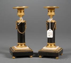 Pair of French Empire Gilt Bronze Candlesticks