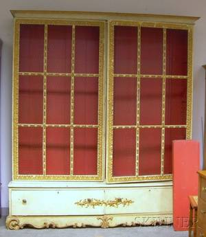 Italianstyle Gilt and Painted Carved Wood TwoDoor Bookcase over Two Short Drawers