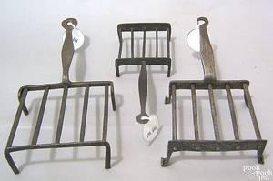 Three diminutive Pennsylvania wrought iron broilers 18th c