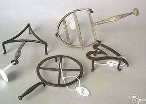 Delicate wrought iron triangular trivet