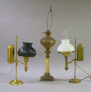 Two Brass Student Lamps and a Late Victorian Metal and Onyx Kerosene Banquet Lamp