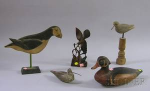 Four Carved and Painted Wooden Bird and Duck Figures and an Asian Rosewood Bird Figural Group