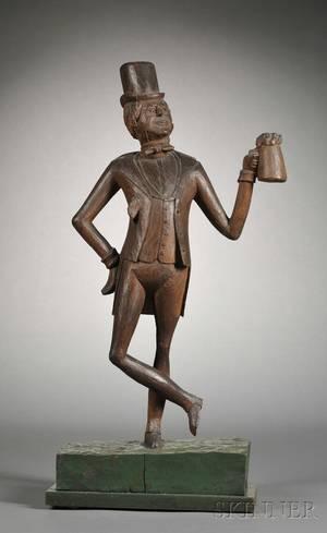 Carved Wood Figure of a Taverner