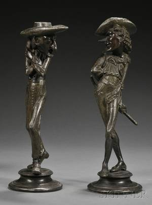 Pair of Patinated Metal Figural Candlesticks