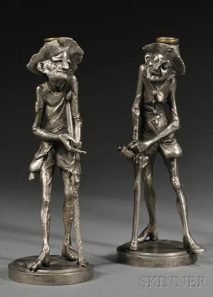 Pair of Silvered Metal Figural Candlesticks