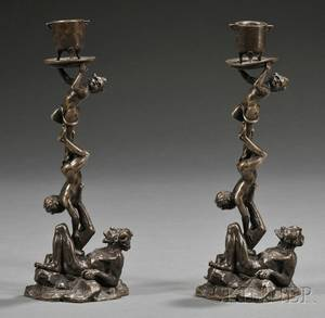 Pair of Figural Bronze Candlesticks