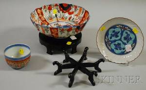 Three Asian Porcelain Bowls and a Hardwood Stand