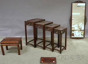 Four Asian Carved Hardwood Nesting Stands a Carved Rosewood Mirror a Carved Hardwood Stand and a Small Tray