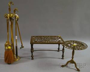 Set of Four Brass Horsehandled Fireplace Tools and Stand a Similar Hearth Trivet and Another Brass Hearth Trivet