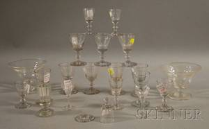 Eighteen Colorless Blown Glass Cordials and a Pair of Compotes