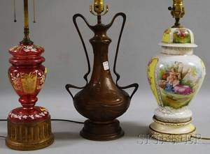 Austrian Transferdecorated Porcelain Covered UrnTable Lamp a Late Victorian Enameled Cranberry Glass JarTable Lamp and an Art N