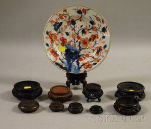Japanese Imari Plate and a Group of Small Asian Carved Hardwood Stands