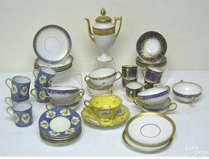 Partial porcelain tea services to include Cauldon cups and saucers