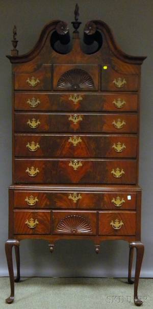 Queen Annestyle Carved Mahogany and Mahogany Veneer Bonnettop Highboy