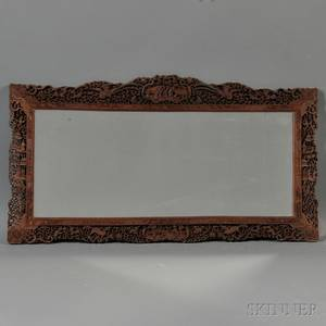 Mirror with an Ornate Wood Frame