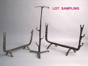 Two wrought iron hearth tool rests late 18thearly 19th c