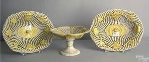Three pcs of yelloware to include a pair of English reticulated baskets