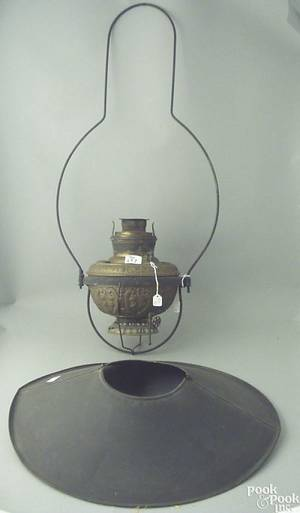Large brass hanging fluid lamp with a tin shade