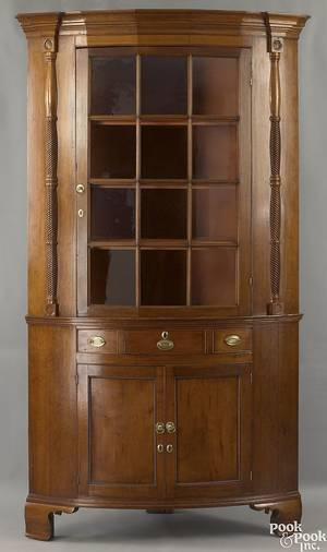 Pennsylvania Federal cherry one piece corner cupboard ca 1810