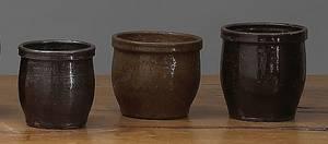 Three redware pots 19th c
