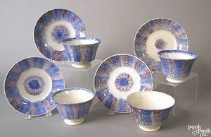 Four blue and purple rainbow spatter cups and saucers 19th c