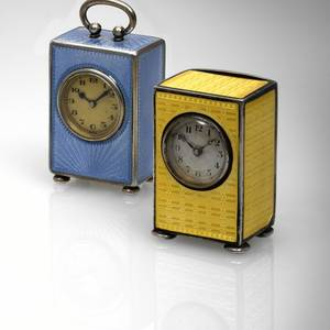 A PAIR OF SILVER AND ENAMEL MINIATURE CLOCKS A