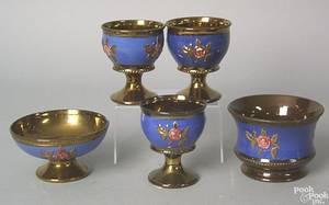 Five pieces of copper luster to include 3 goblets with rose decoration on a blue ground and 2 footed bowls with similar decoration