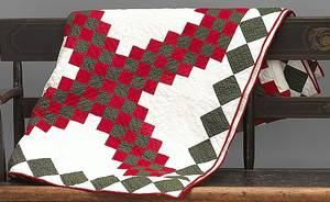 Vibrant red green and white pieced quilt 19th c