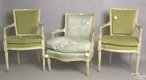 Seven French Louis XVI style painted fauteuils