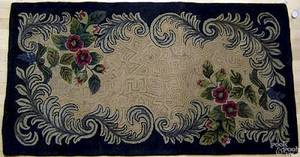 Three American hooked rugs with floral decoration