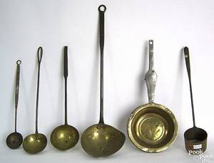 Four wrought iron brass and copper ladles early 19th c