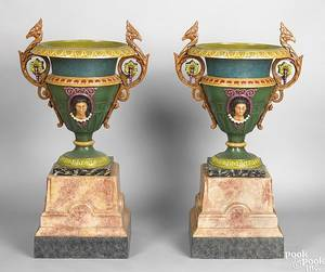 Pair of painted cast iron garden urns on stands late 19th c